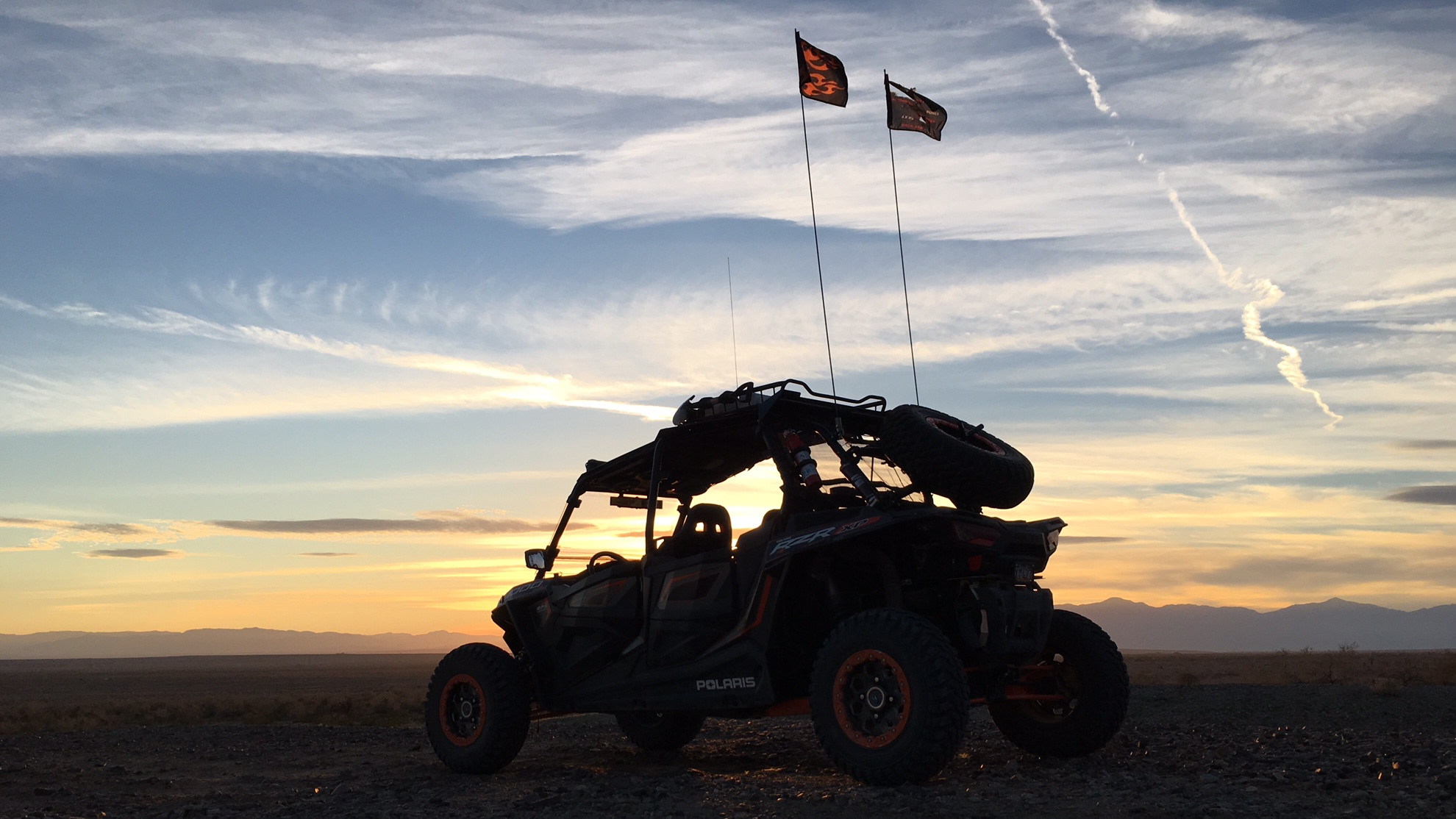 PIcture of ATV with sunset in the background